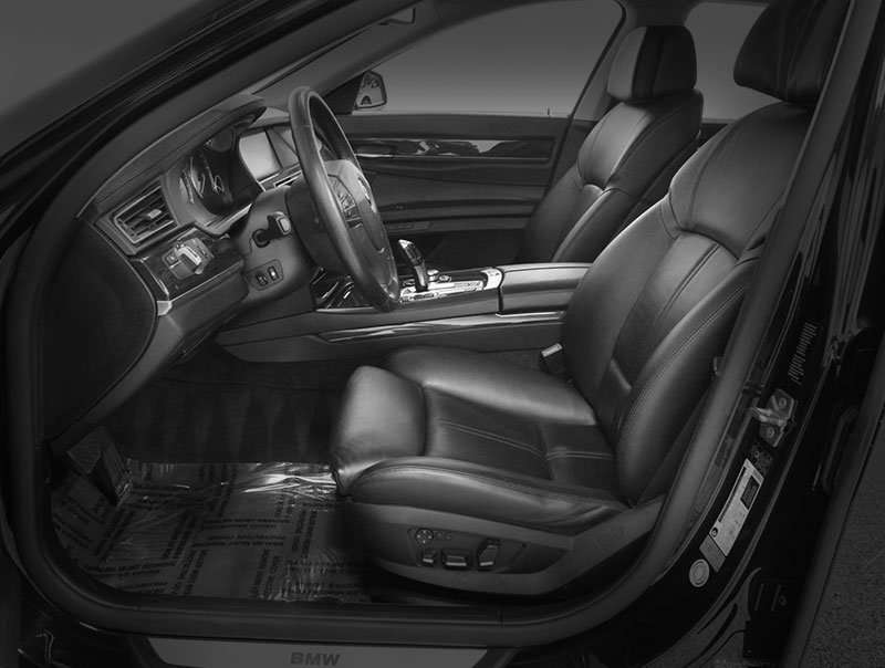 A photograph of a meticulously well detailed vehicle interior - Interior Detail by Automotive Quality Solutions